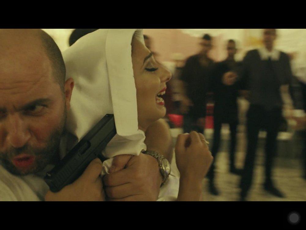 Doron taking the bride hostage