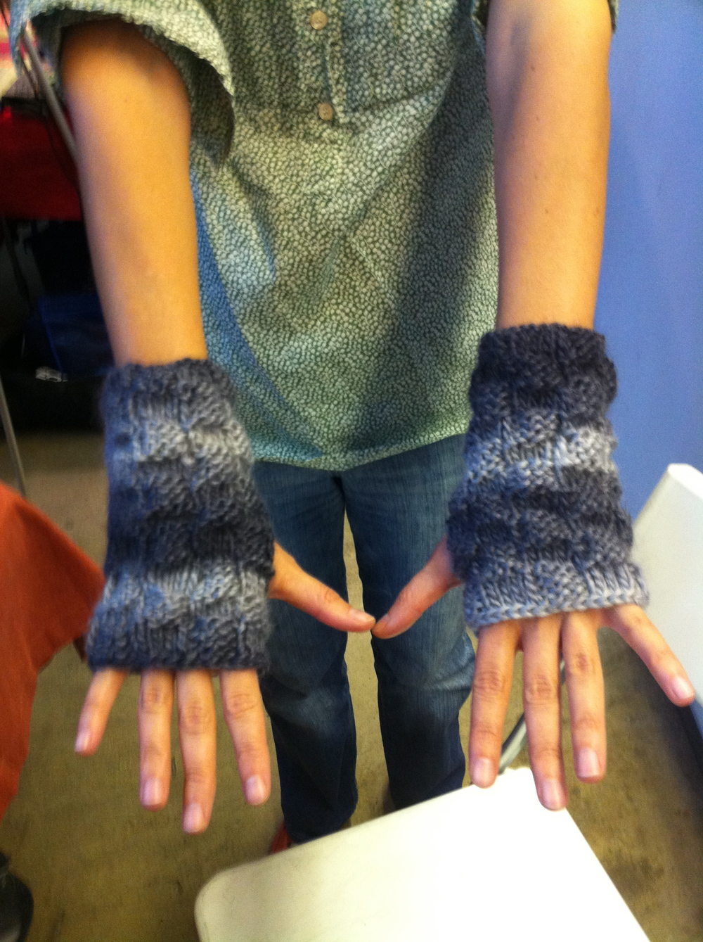 "Among her many talents, Farrah is an expert knitter and on autumn Flea weekends we offered her hand-knit fingerless gloves (often knit on the spot that very day!) as ""poetry mitts,"" perfect for thumbing pages and keeping your hands warm."
