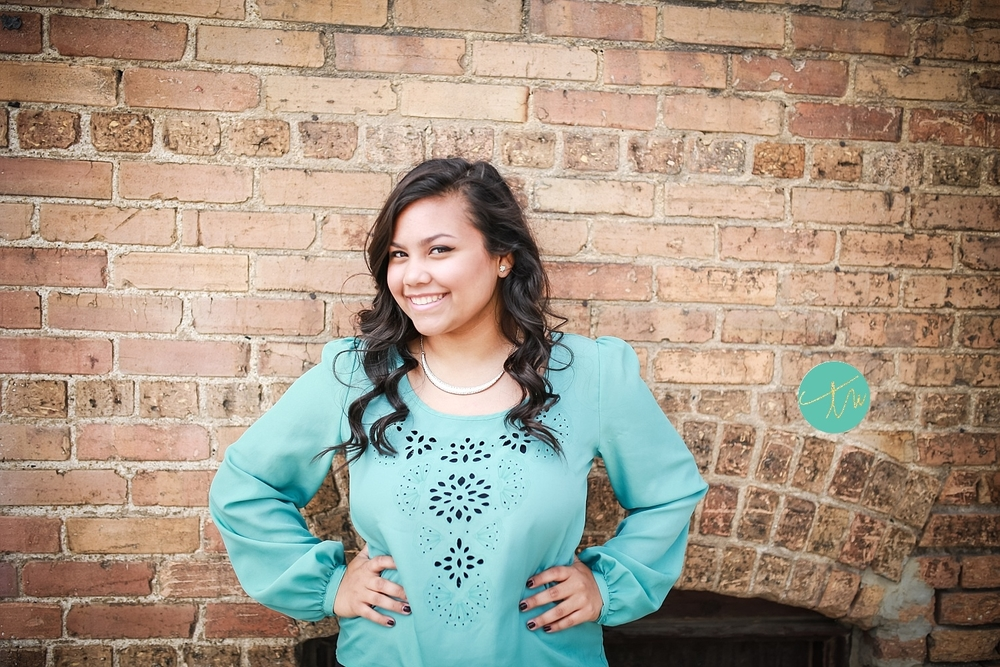 brick wall senior portraits