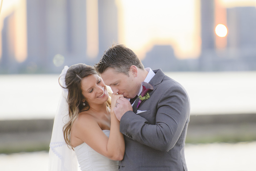 """Jessilynn provided us with a full-day of coverage on wedding day. She set the scene for a wonderful """"First Look"""" which was special and intimate and captured our excitement perfectly. Our venue was on the lake in Toronto, so our shots on the dock with the sunset were absolutely stunning. Jessilynn and her Assistant were both extremely professional throughout the day and very unobtrusive. The proof is in the pudding, because when it came down to choosing our photo for our photobook, we had a very hard time narrowing down the photos. Thank you for capturing our day so beautifully Jessilynn! Natalie Jacyk & Matt Lennox"""