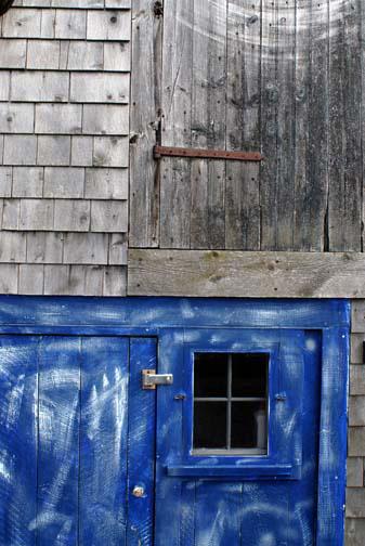 woodenbuildingbluedoor.jpg