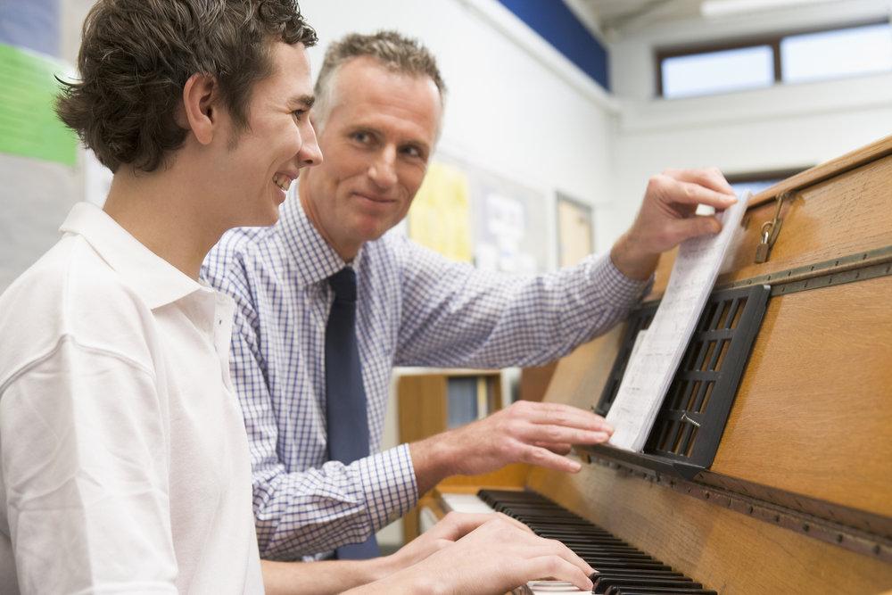 bigstock-Teacher-Helping-Teen-Pupil-To--3916416.jpg