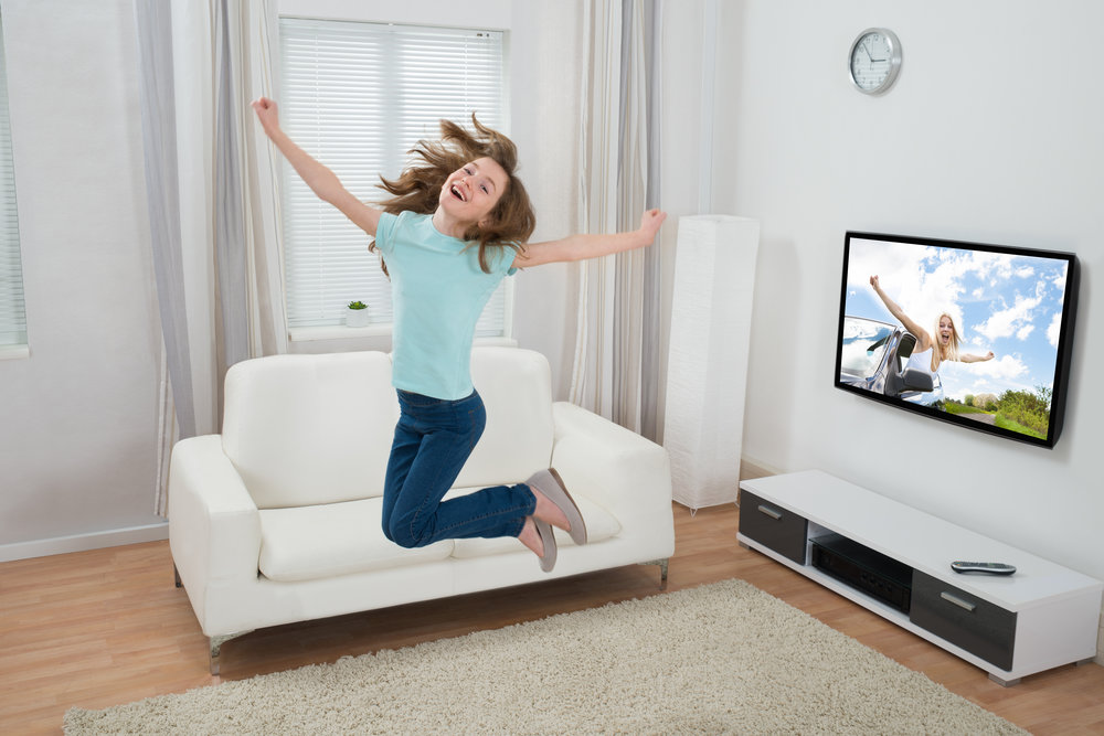 Girl Jumping In Living Room