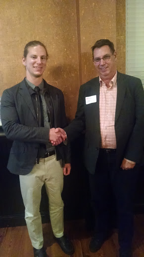 This year's scholarship winner, Samuel Horochowski, shakes hands with Frank Dittenhafer.