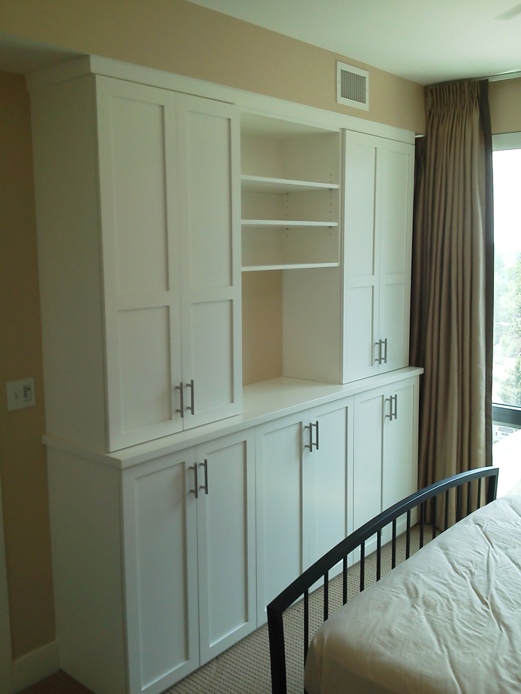 White lacquered wardrobe and display.