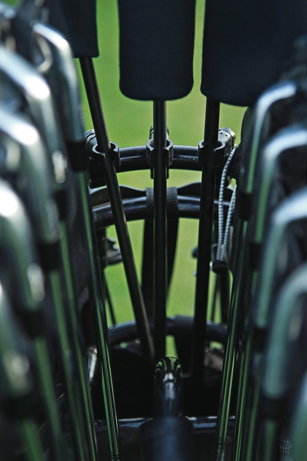 "PROTECT.  Patented ""shaft-clips"" holds woods and hybrids in place all the time."