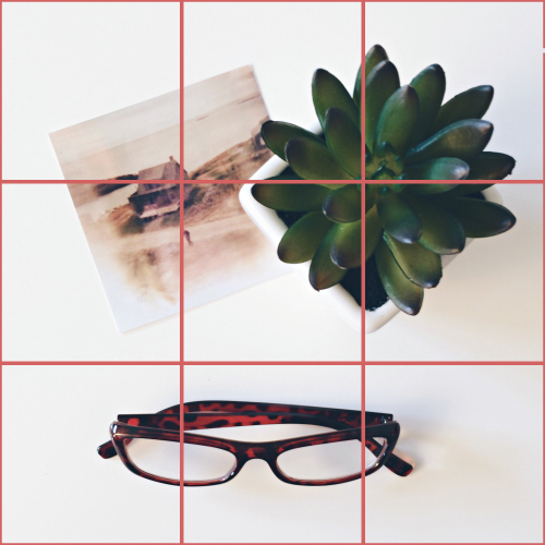 Rule of Thirds - place one item at one of the spots where the horizontal and vertical lines cross. Then arrange other 2 items around the first.
