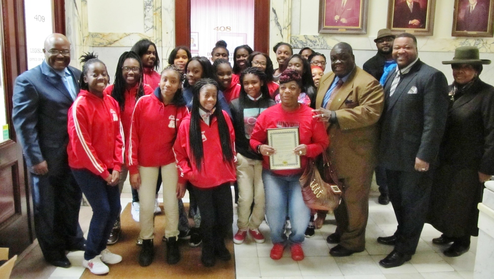 Young athletes receiving a proclamation from members of the Democratic Caucus.