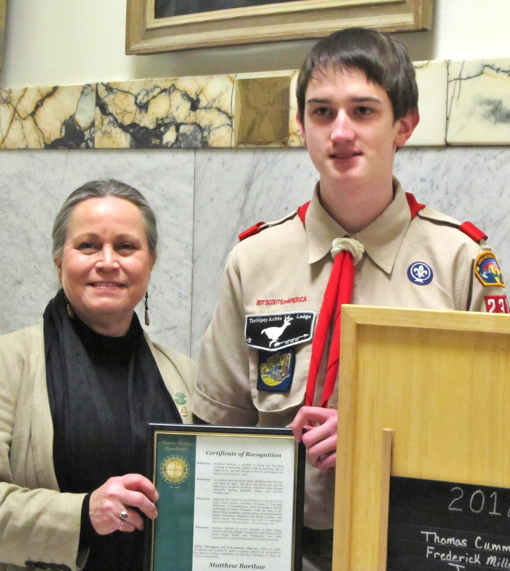 Legislator Kaleh recognizes Eagle Scout Matthew Bartlow for his Eagle project, which created a travelling memorial to those who have received indigent burials in Monroe County.