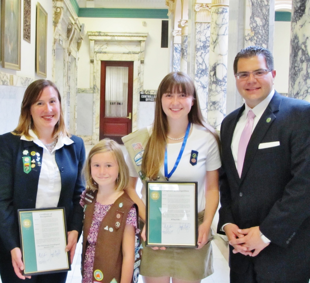 Legislator Morelle honors scouts with proclamations at a meeting of the Legislature.