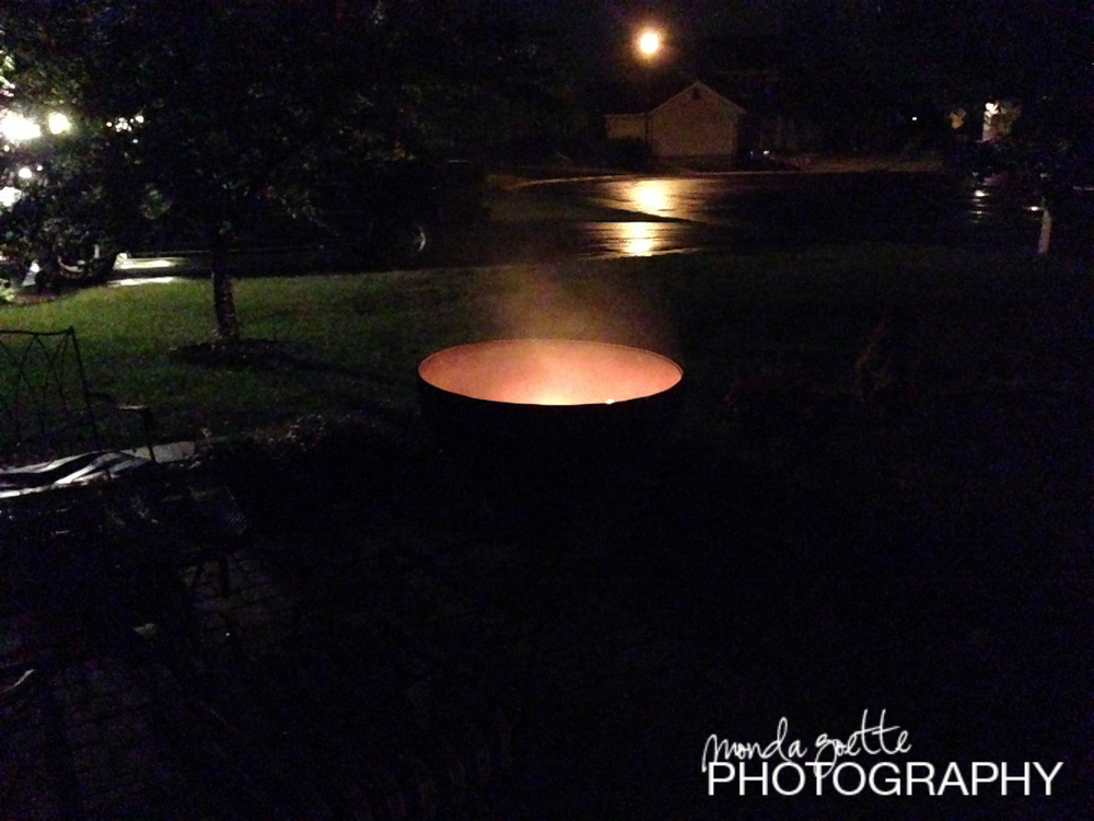The awesome firepit still burns even when it was raining.