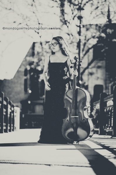 Abby in her concert performance dress, along with her prized cello.