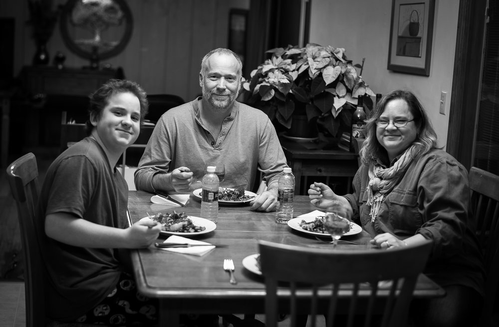 Trent pictured with his mom and dad with the meal we all prepared together!