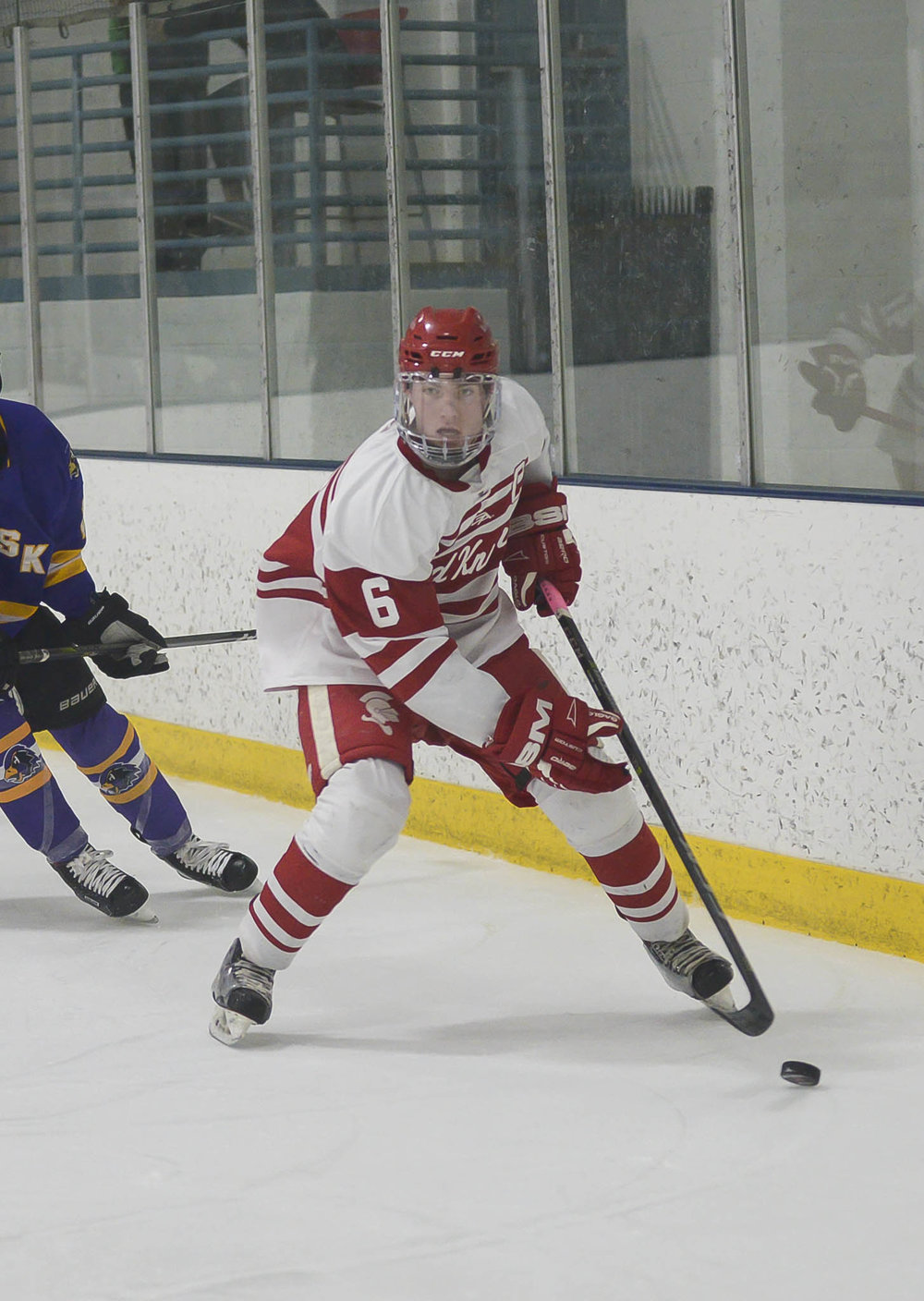 Captain Nate handling the puck at a BSM Boys' Hockey home game vs CHaska Hawks. Photo by Monda Goette Photography