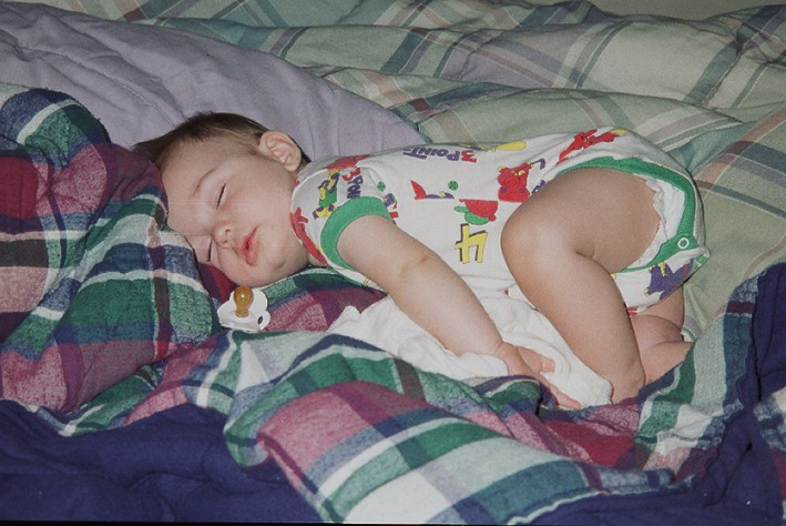 """Baby Joey with his """"nukie"""" and blankie nearby. Note: I still use this darker plaid blanket, it's on it's last leg though!"""