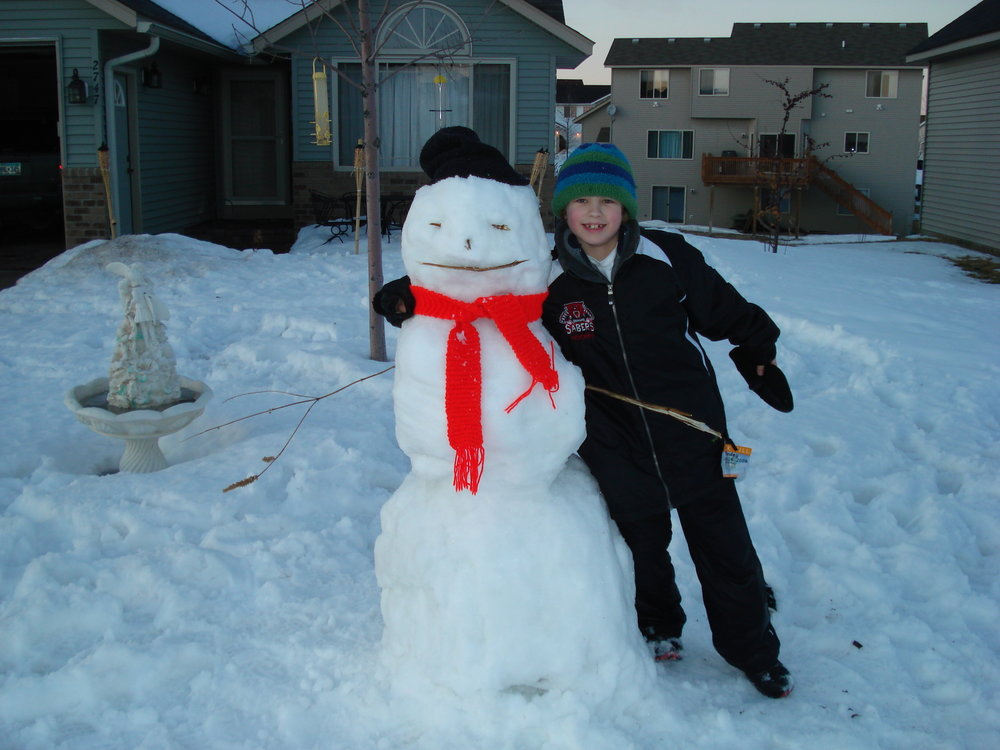 Probably the last time Joey built a snowman in our front yard!