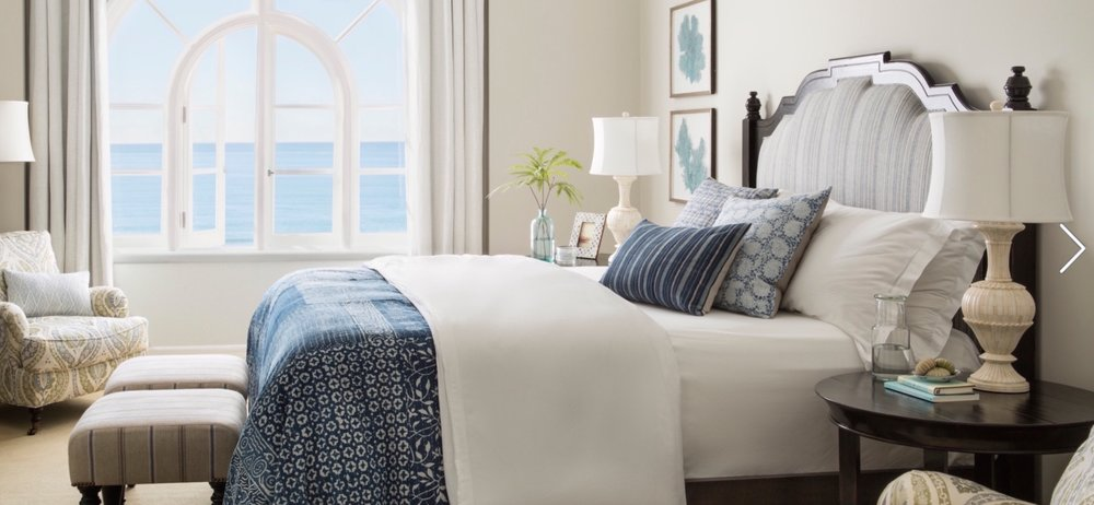 Coastal bedroom featuring the Greenwich upholstered bed from Rooms & Gardens