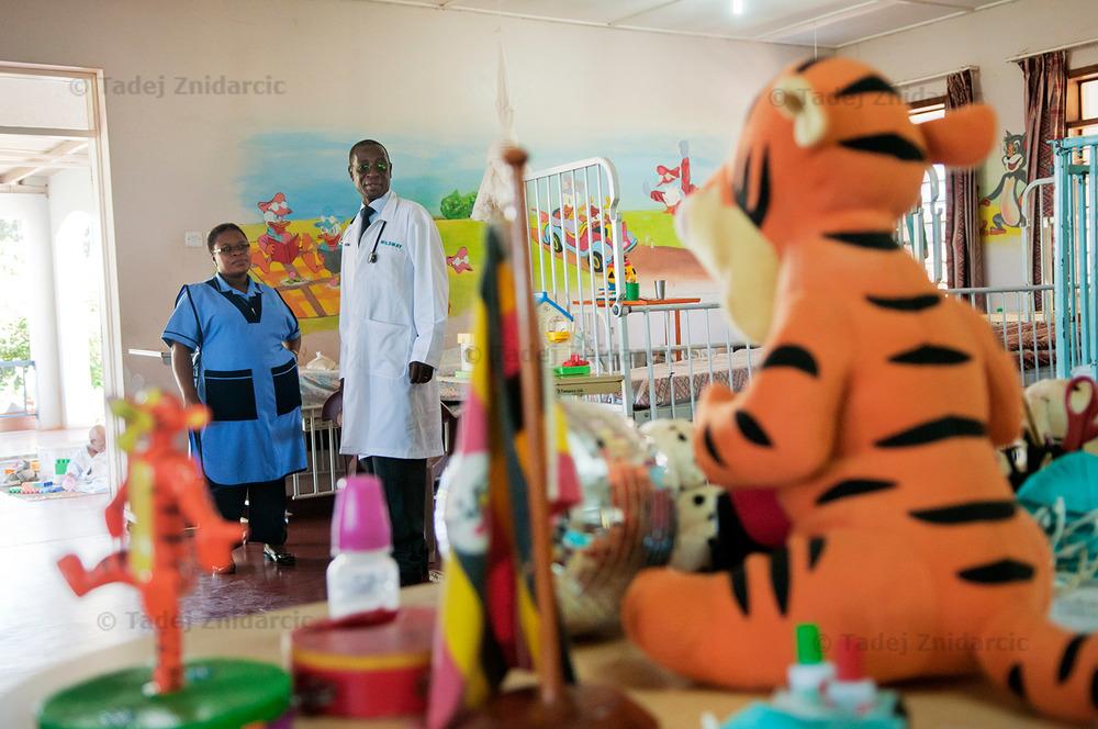 Dr. Stephen Watiti and nurse Rose Nannyonjo visit children's ward at Mildmay hospital.