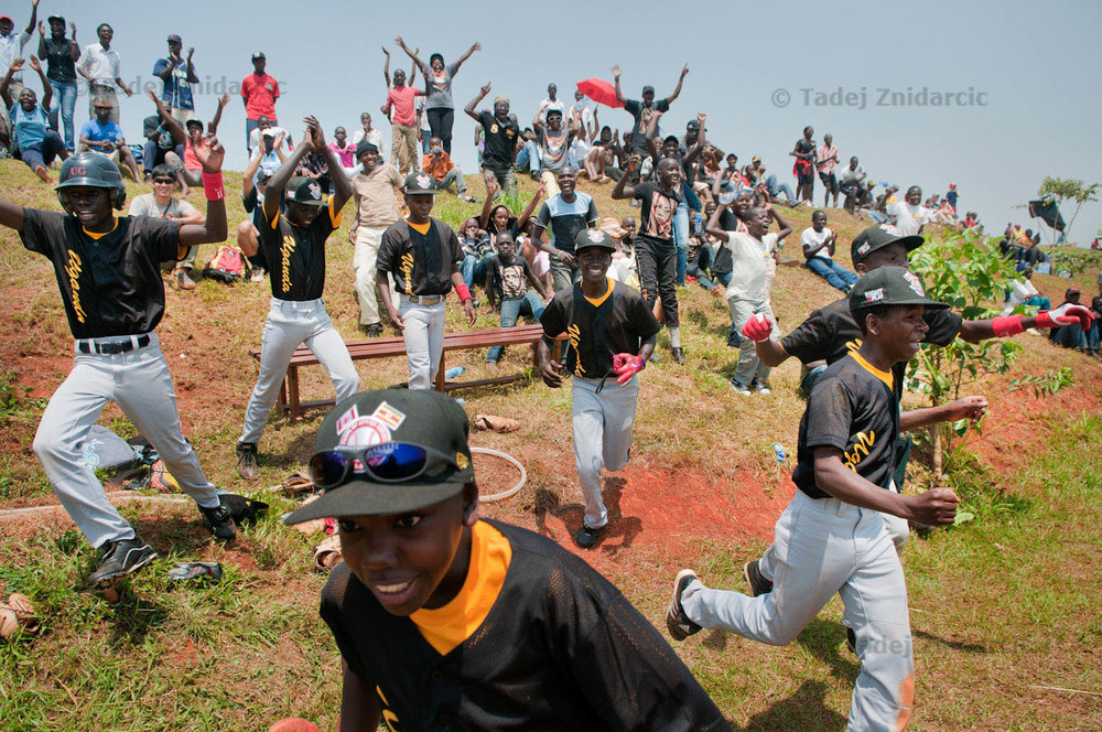 Players from Ugandan Little League baseball team celebrate their victory over a Canadian team.