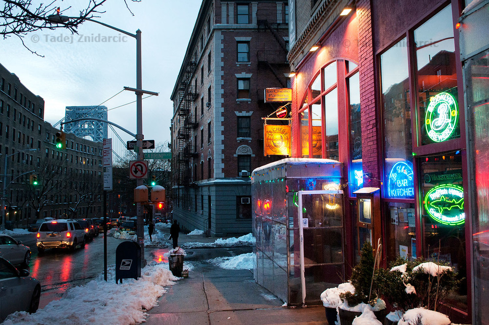 View of Le Cheile restaurant on 181st street withGeorge Washington bridge in the background.