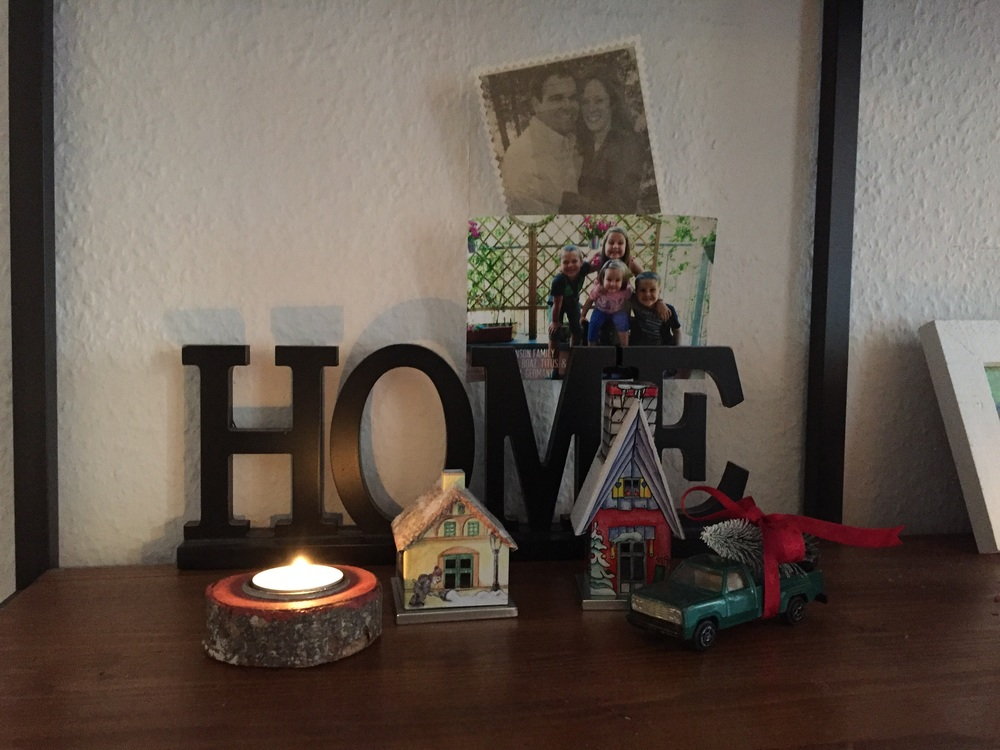 Let your kids help decorate. Use what you have. The boys searched high and low in their toys for the perfect pick up truck for our little tree. These little houses are smoke houses. You put a little incense candle in them and smoke comes out the chimney!
