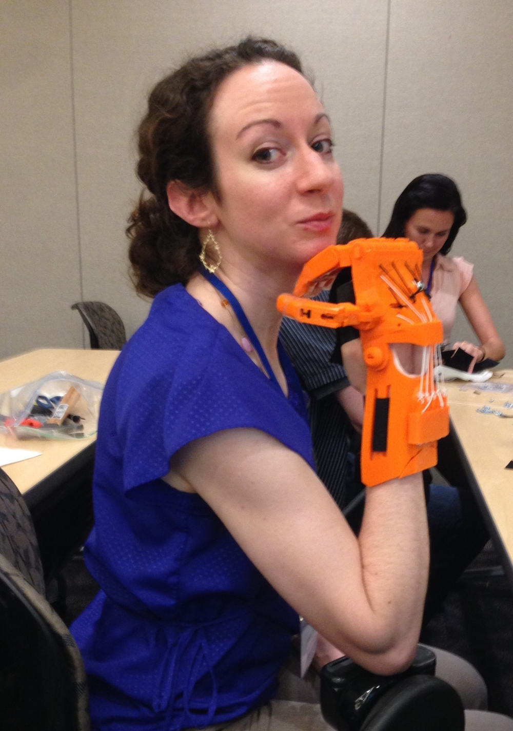 Angie Swindell, our Clinical Director models a device.