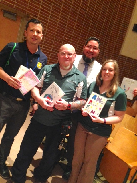 Left to Right - Brad Sweet (STEM program), Art Ross, Timm Green (STEM program), and Kristen Beltran holding student books.