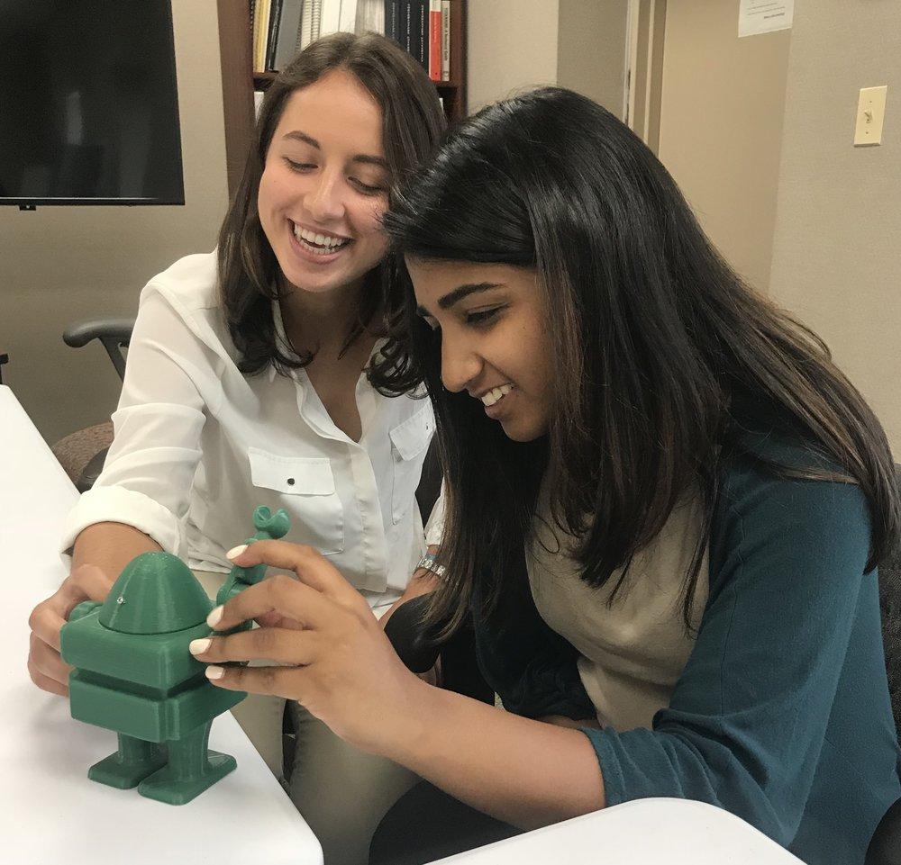 Clara (L) and Shaina (R) meet 3DPO.