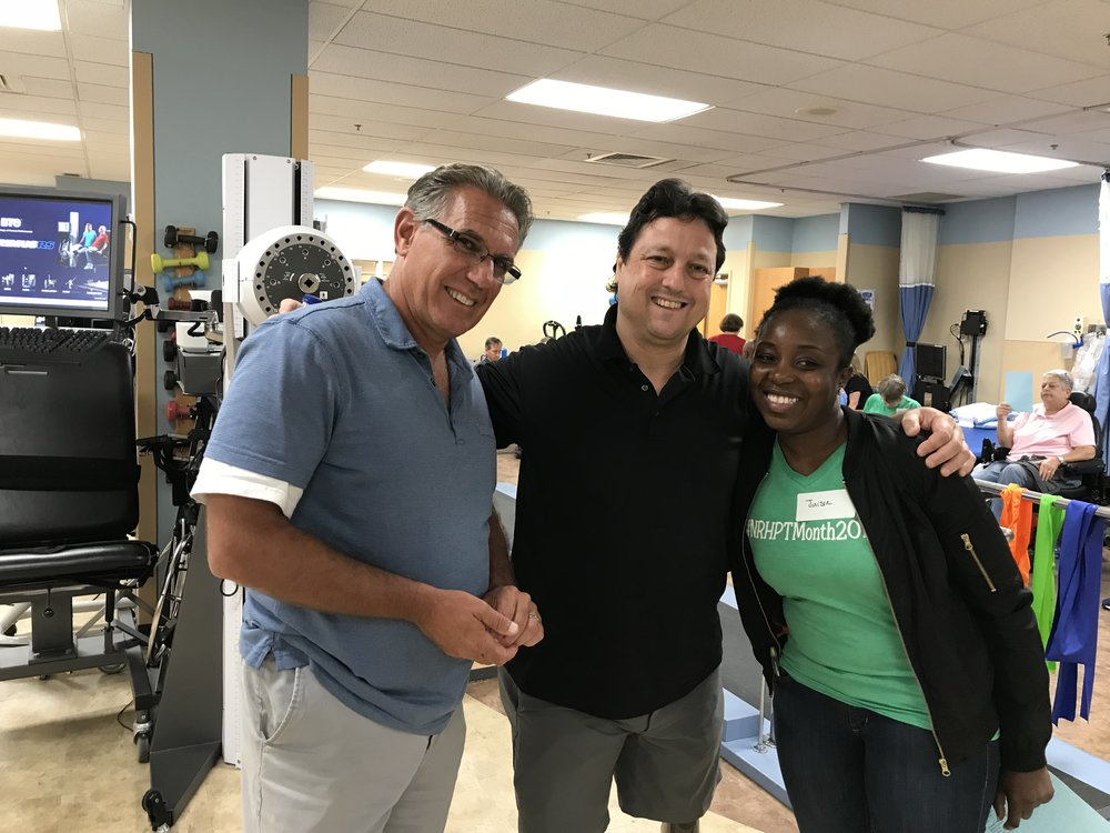 Dennis (L) and Todd (Center) with a past participant of Amputee Walking School.