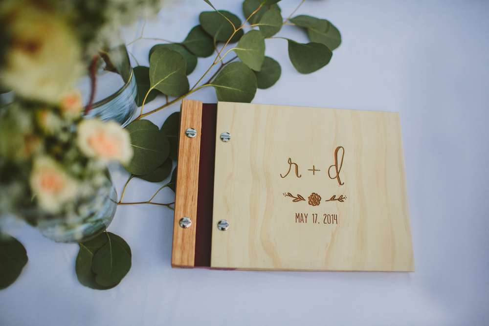 They even wood-burned their logo on the front of their guestbook!