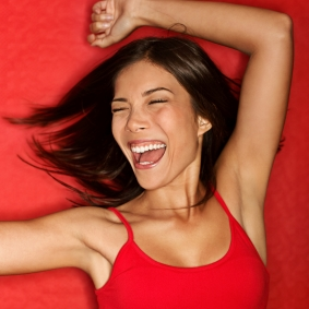 Dancing happy woman in red
