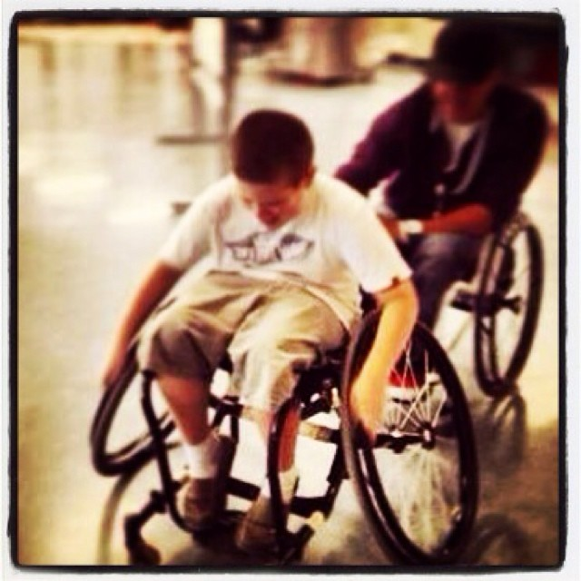 Helping a blind student feel accepted by having the same experience as his classmates, pushing my tennis wheelchair