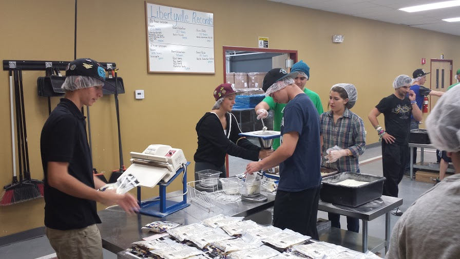 These Libertyville Liberators packed 54 boxes of food - providing 32,400 meals to those less fortunate.