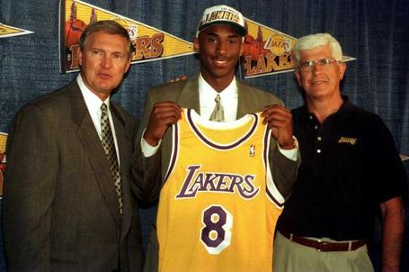 Kobe Bryant posing with then Lakers' General Manager, Jerry West and former head coach, Del Harris, after the Lakers acquired his rights during the 1996 NBA Draft from the Charlotte Hornets in exchange for center Vlade Divac.