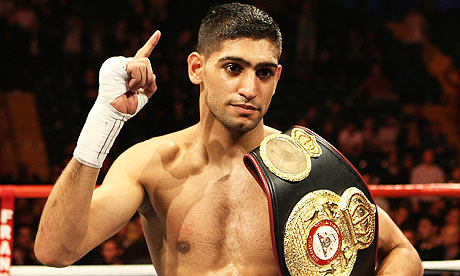 "Amir ""King"" Khan raising his hand in victory - his eyes have long been on a showdown with Mayweather."