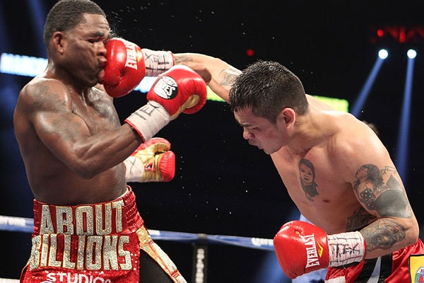 Maidana landing a huge blow on the face of Adrien Broner. Maidana's victory over Broner (aka 'little Floyd') set up his May-2014 brawl with Mayweather.