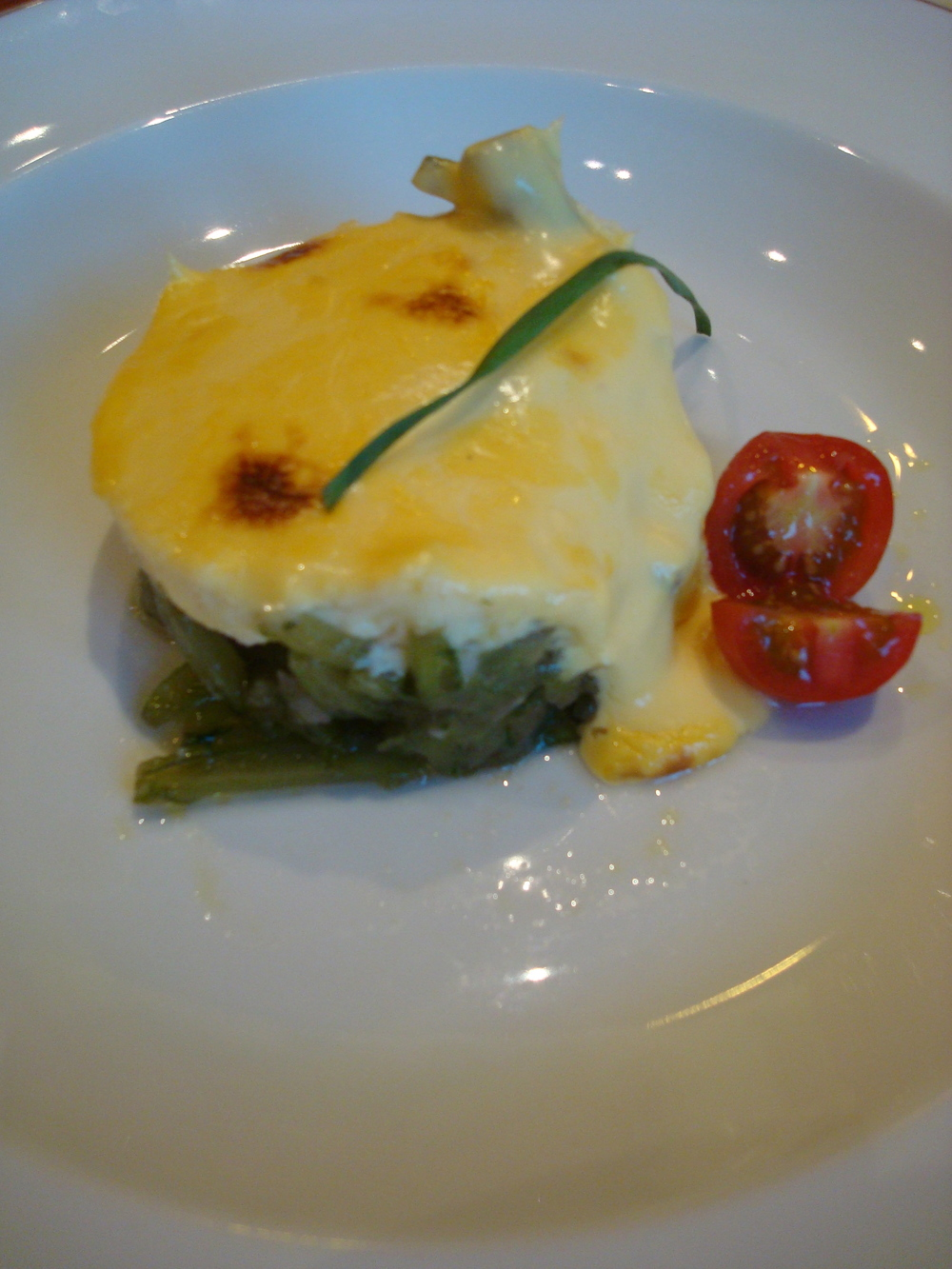 Cardo with cod and hollandaise. Cardo is a local vegetable with a celery-like texture that takes a little like mild asparagus