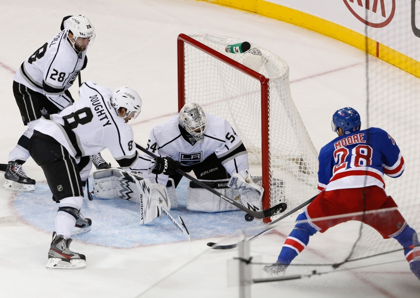 Nov 17, 2013; New York, NY, USA;  Los Angeles Kings goalie Ben Scrivens (54) deflects the puck shot by New York Rangers center Dominic Moore (28) during the third period at Madison Square Garden. Kings won 1-0.  Mandatory Credit: Anthony Gruppuso-USA TODAY Sports