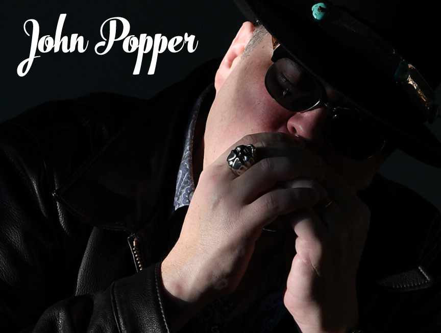 John Popper - is an American musician and songwriter. He is most famous for his role as frontman of rock band Blues Traveler performing harmonica, guitar, and vocals.