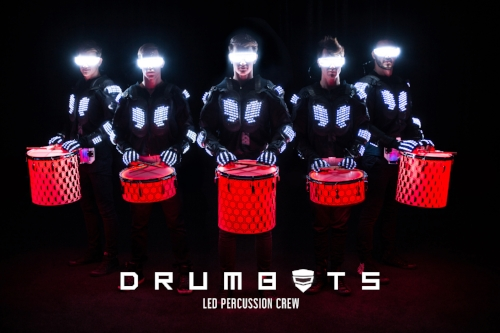 Drumbots - Flashing, pulsing and glowing to the beat, Drumbots awaken audiences with an energetic performance and spectacular lighting! The LED percussion crew consists of 2-8 performers that roam independently through the audiences, aligning their beats and completely immersing the spectators in the action. Drumbots are created to elevate the energy at your next event, and be adaptable to each event and venue.