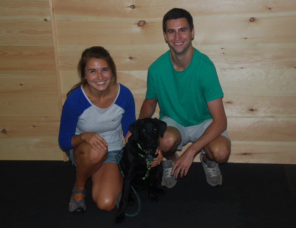 "Chelsea, Lucia and Kory ""I had a few nights filled with tears and my husband wondered what in the world we did by getting a puppy.  Then we went to classes with Sue and now we don't know what we'd do without our happy Lab!  We are looking forward to taking many more puppies to Sue's classes."""