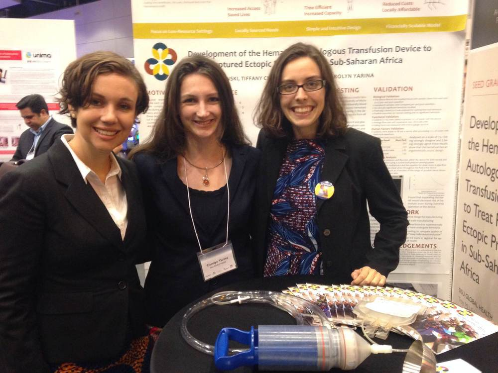 The Sisu Global Health team at the Saving Lives at Birth Development XChange. In the foreground, the Hemafuse is pictured next to another autotransfusion tool in Sub-Saharan Africa: the stainless steel soup ladle.