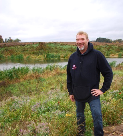 Conservation award winner Marc Bercier stands near the reinvigourated area of his farm, which supports pollinating insects and the overall environmental objectives of his business.