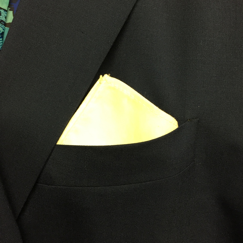 "Here the pocket square is folded into a square, and the four points are together. Just makes more a crisp ""blocking"" effect."