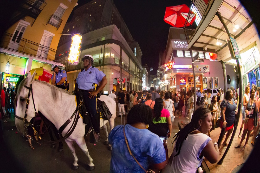 Mounted officers and party goers cross paths