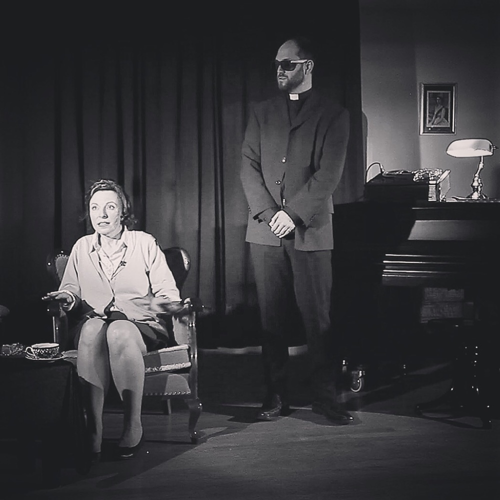 Tom during a scene as Reverend Dearborne