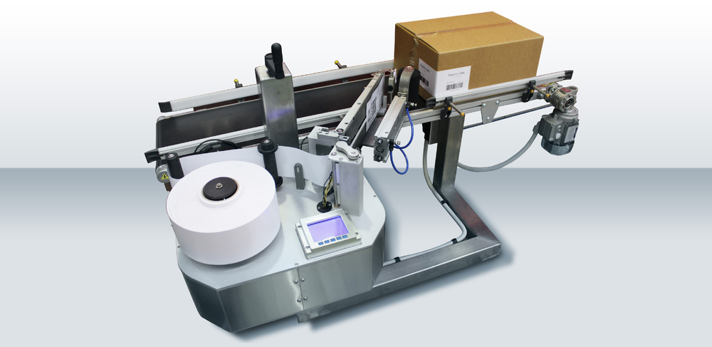 The HM Linerfree System Label rolls with no backing liner means zero waste. Thermal direct paper means no ribbons and no inks.Can be supplied on self supporting stand or mounted to conveyor frame as shown.