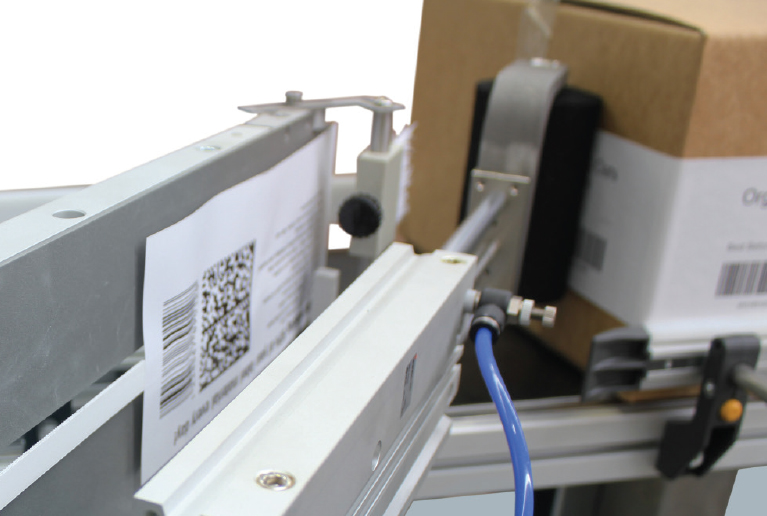 Optional wrap roller will wrap label around the corner for adjoining panel label if required.