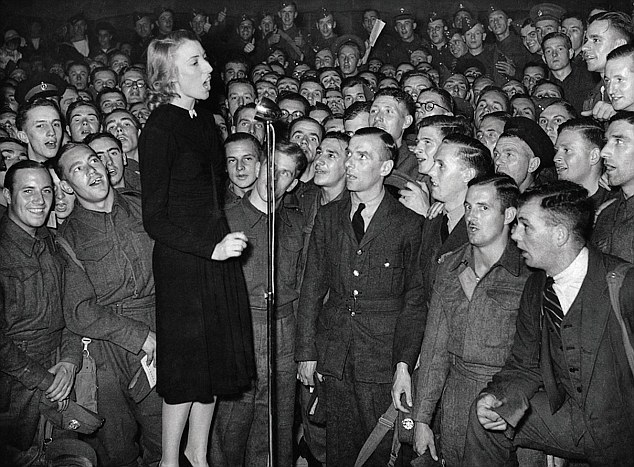 Vera Lynn singing for (and, it appears, with) the troops in WWII.