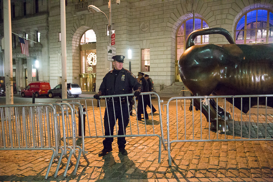 Police officers barricaded the Charging Bull.